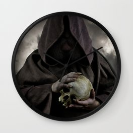 Holding a male skull Wall Clock