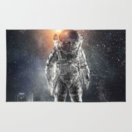 galaxy astronaut Standing alone in the city Rug