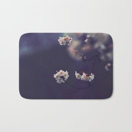 Beautiful White Flower Blossoms Against Purple Background Bath Mat