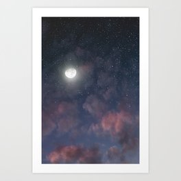 Glowing Moon on the night sky through pink clouds Art Print