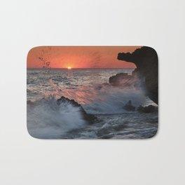 Red Sun Through The Waves. Roche Reefs At Sunset. Bath Mat