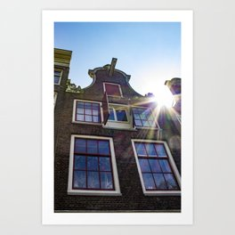 Sun Rays Peeking over the Roof of a Traditional Amsterdam Canal House Art Print