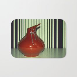 Red vase with jewelry Bath Mat