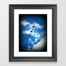 Birds on a Wire -- White clouds, blue sky Framed Art Print