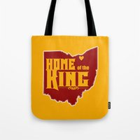 lebron Tote Bags featuring Home of the King (Yellow) by Denise Zavagno