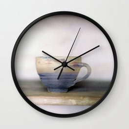 tempest in a teacup Wall Clock