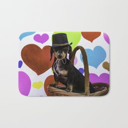 Black and Tan Dachshund Puppy Wearing a Top Hat in front of Valentine's Day Heart Background Bath Mat