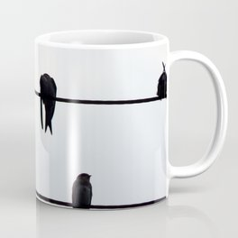 Birds sit on the electric wires of the school Coffee Mug