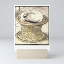 Sleeping Cat on Wicker Table Mini Art Print