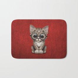 Cute Brown Tabby Kitten Wearing Eye Glasses on Red Bath Mat