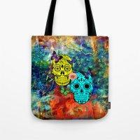 sugar skulls Tote Bags featuring Sugar Skulls by haroulita