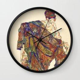 Woman in multicolourd coat by Egon Schielle Wall Clock