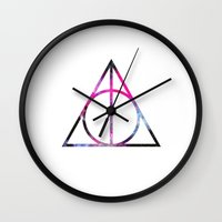 deathly hallows Wall Clocks featuring The Deathly Space Hallows by Enyalie
