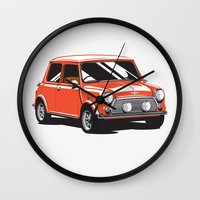 mini cooper Wall Clocks featuring Mini Cooper Car - Red by C Barrett