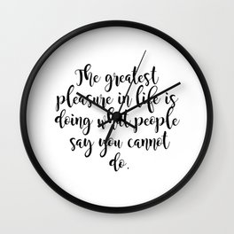 The greatest pleasure in life Wall Clock