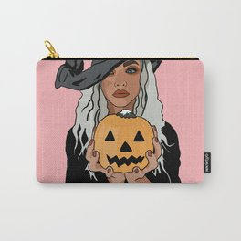 Woman in black witch costume holding Halloween pumpkin - pink background Carry-All Pouch