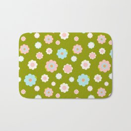 White, blue and pink flowers over green background Bath Mat