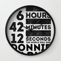 donnie darko Wall Clocks featuring Donnie Darko 28:6:42:12 by Eric Schroeder