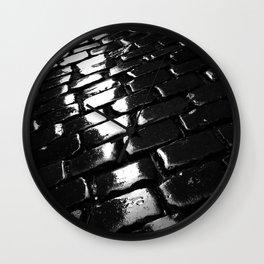 shot on iphone .. wet cobblestones Wall Clock