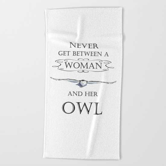 Never get between a woman and her owl Beach Towel
