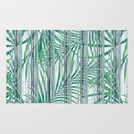 Palm leaves on a striped background. Rug