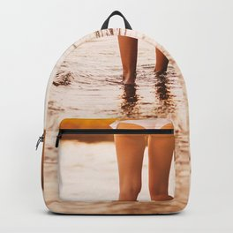 Low Section Of Young Woman in a white bikini walking Toward Sea on Beach at the sunset. Concept Summ Backpack