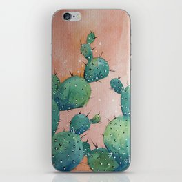 Blue cactus against a pink sky iPhone Skin