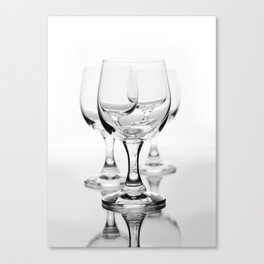 Three empty wine glasses on white Canvas Print
