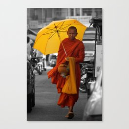 Monk on city street Canvas Print
