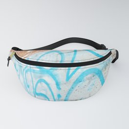Blue graffiti on concrete wall Fanny Pack