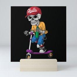 Skull riding a scooter Mini Art Print