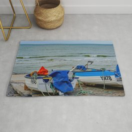 Traditional crab fishing boats on Sheringham beach Rug