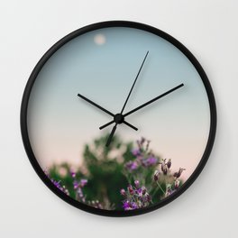 Wild flowers in the forest with full moon at dawn Wall Clock