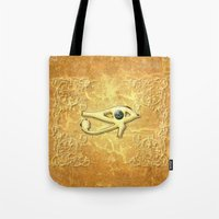 all seeing eye Tote Bags featuring The all seeing eye by nicky2342