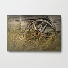 Broken Wheel of a Farm Wagon in the Grass on the Prairie Metal Print