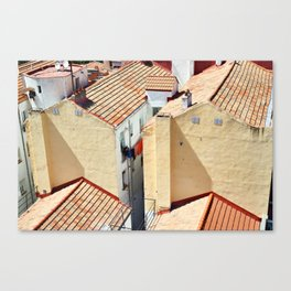 Old houses in poor quarter with tiled roofs Canvas Print