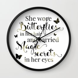She wore butterflies in her hair and carried magic secrets in her eyes Arundhati Roy Quote Wall Clock