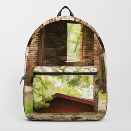 Abandoned brick building in the woods Backpack