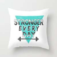 crossfit Throw Pillows featuring Stronger Every Day (barbell) by Lionheart Art