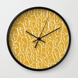 faces / mustard Wall Clock
