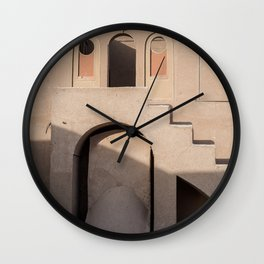 Shadow on the wall of a brown building with little windows | ancient architecture of Iran Wall Clock