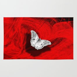 Silver butterfly emerging from the red depths Rug