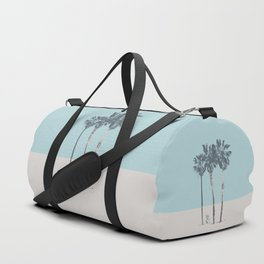 Palm trees on a solitary beach Duffle Bag