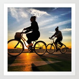 Cycling on sunset in Santa Monica, California, USA Art Print