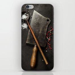 old wooden spoon and Meat cleaver knife on dark background iPhone Skin