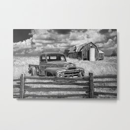 Black and White of Rusted International Harvester Pickup Truck behind wooden fence with Red Barn in Metal Print