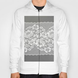White color straight strip of lace fabric on gray background. Elastic silk nylon braid border. Hoody