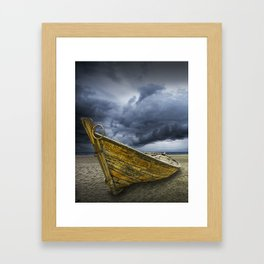 Beached Boat with Storm Brewing Framed Art Print