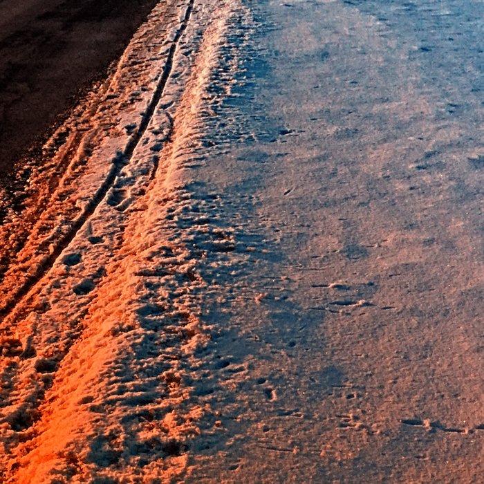 Winter road at sundown Leggings