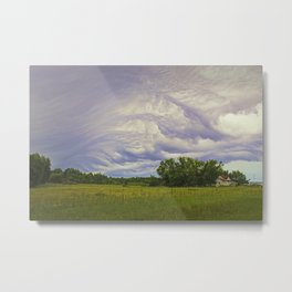 Storm rolling over small farm Metal Print